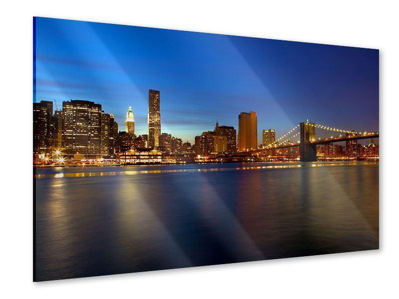 Acrylglasbild Skyline Manhattan im Lichtermeer