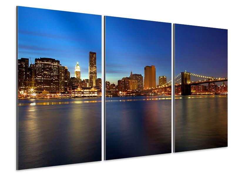 Aluminiumbild 3-teilig Skyline Manhattan im Lichtermeer