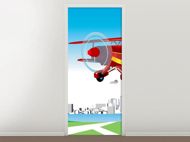 Türtapete Fliegendes Flugzeug