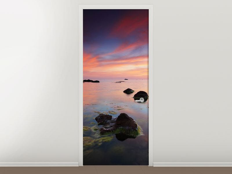 Türtapete Ein Sonnenuntergang am Meer