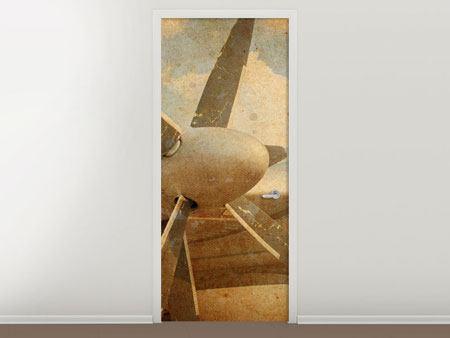 Türtapete Propellerflugzeug im Grungestil