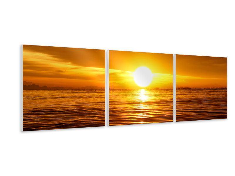 Panorama Hartschaumbild 3-teilig Glühender Sonnenuntergang am Wasser