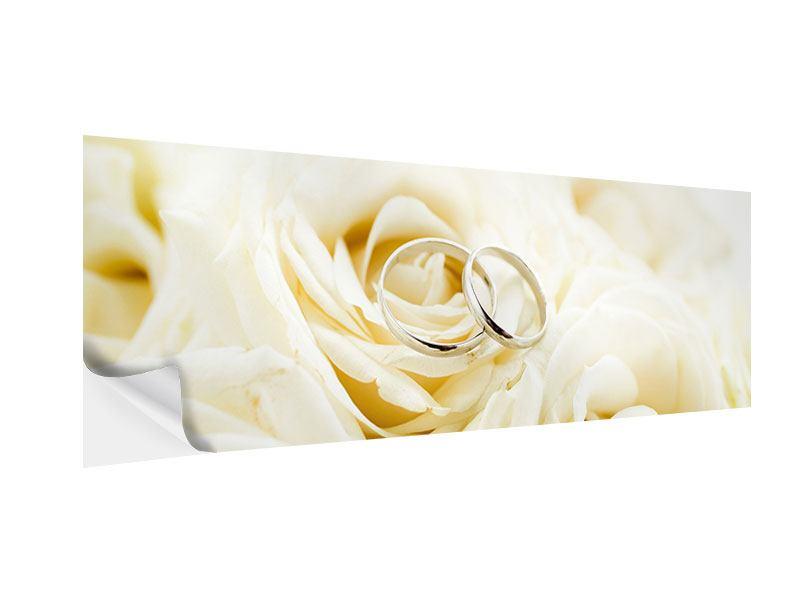 Klebeposter Panorama Trauringe auf Rosen gebettet