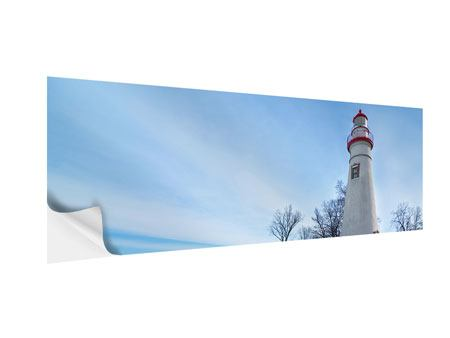 Klebeposter Panorama Leuchtturm im Schnee