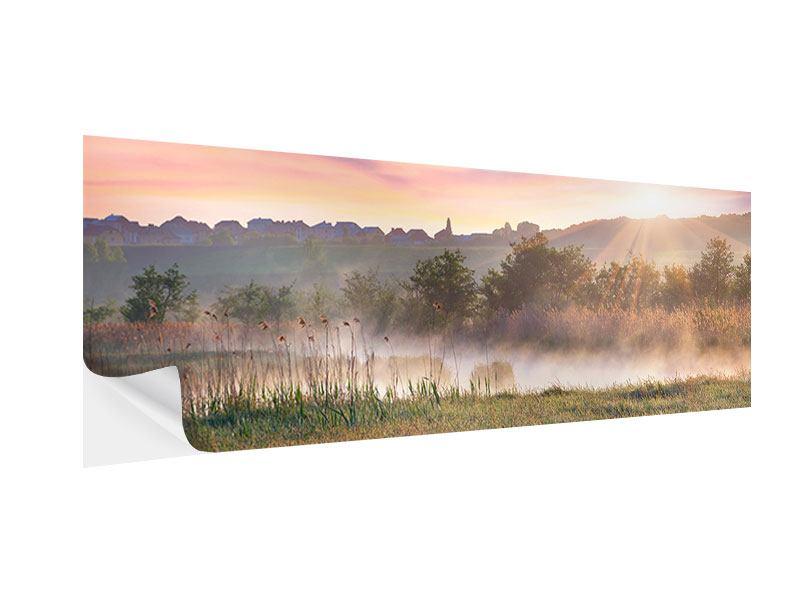 Klebeposter Panorama Sonnenuntergang am Hügel
