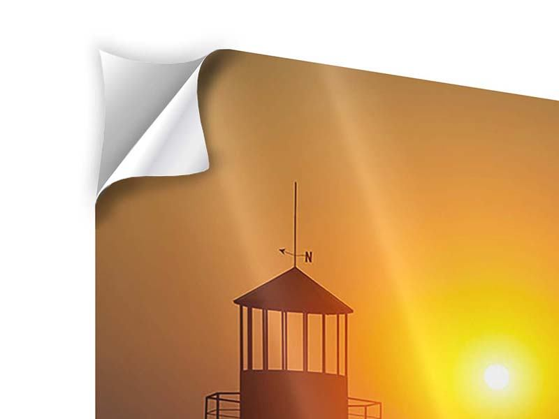Klebeposter Ein Leuchtturm bei Sonnenuntergang