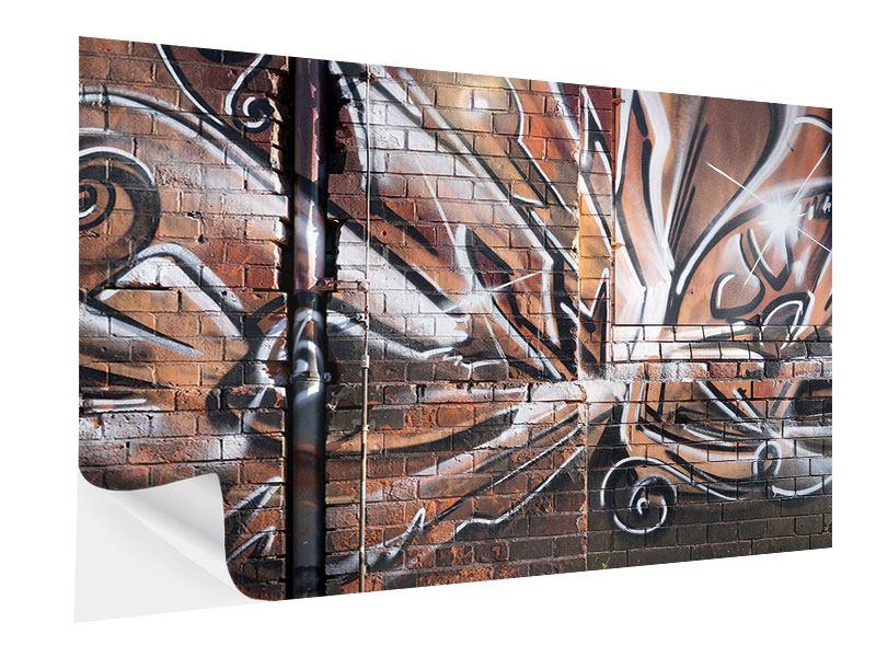 Klebeposter Graffiti Mauer