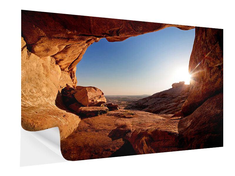 Klebeposter Sonnenuntergang vor der Höhle