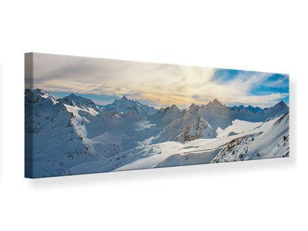 Leinwandbild Panorama Über den verschneiten Gipfeln