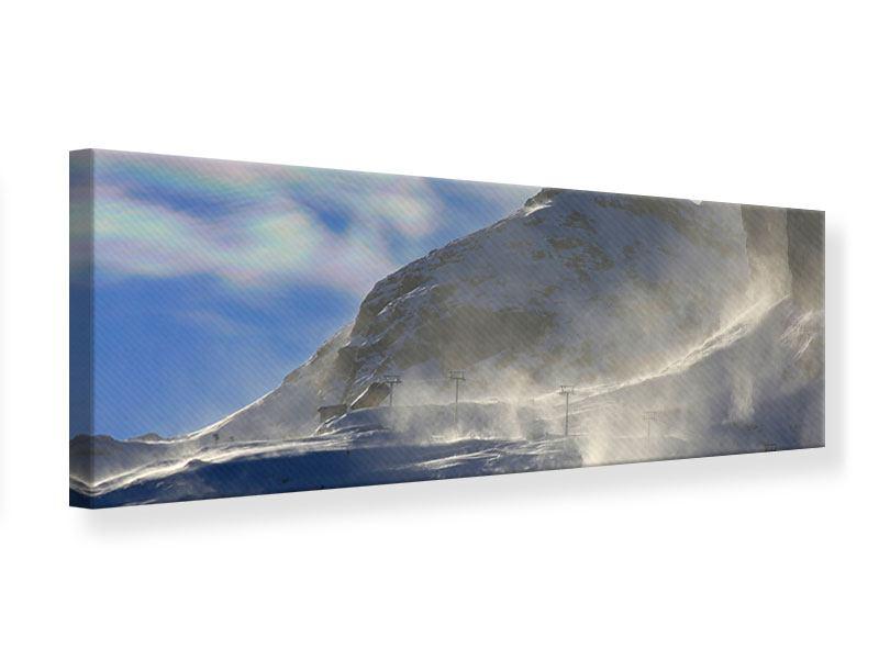 Leinwandbild Panorama Mit Schneeverwehungen den Berg in Szene gesetzt