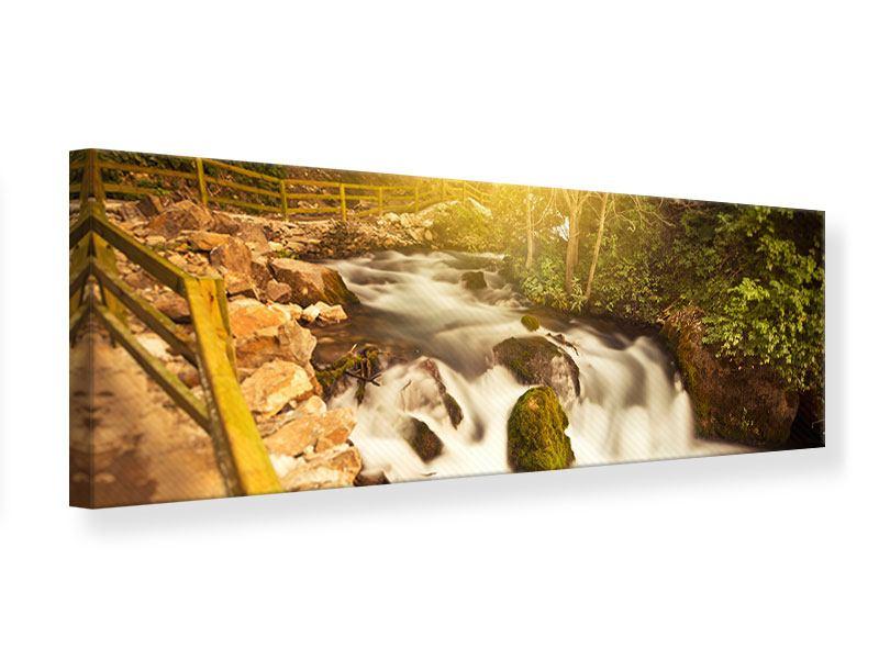Leinwandbild Panorama Sonnenuntergang am Wasserfall