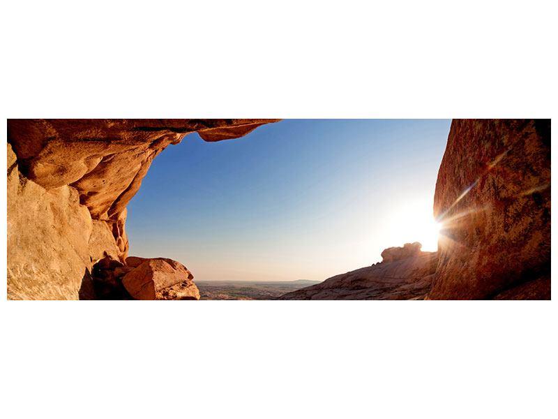 Leinwandbild Panorama Sonnenuntergang vor der Höhle