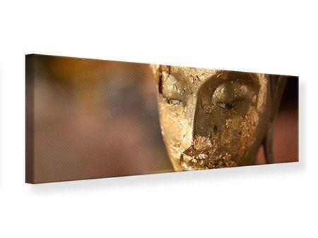 Leinwandbild Panorama Kopf eines Buddhas