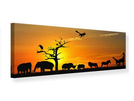 Leinwandbild Panorama Safarietiere bei Sonnenuntergang