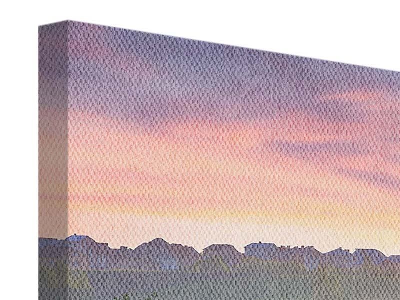 Leinwandbild Panorama Sonnenuntergang am Hügel