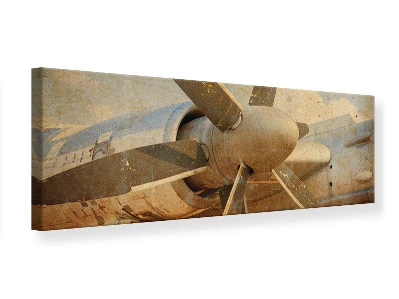 Leinwandbild Panorama Propellerflugzeug im Grungestil