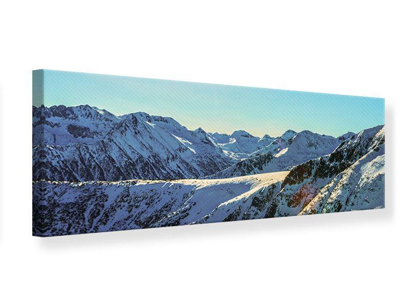 Leinwandbild Panorama Sonnige Berggipfel im Schnee