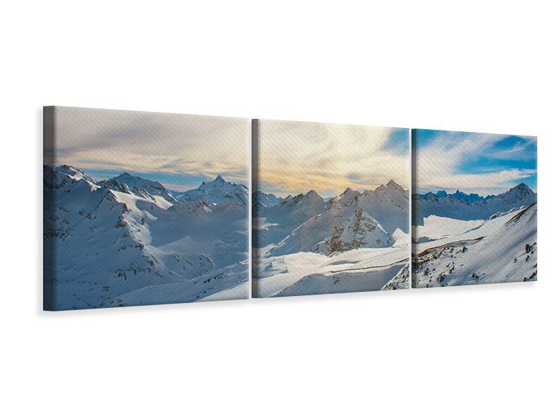 Panorama Leinwandbild 3-teilig Über den verschneiten Gipfeln