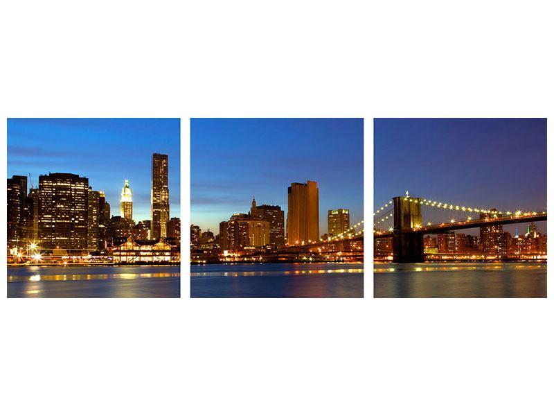Panorama Leinwandbild 3-teilig Skyline Manhattan im Lichtermeer