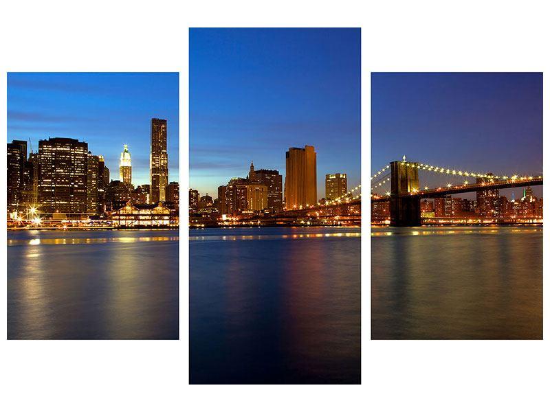 Leinwandbild 3-teilig modern Skyline Manhattan im Lichtermeer