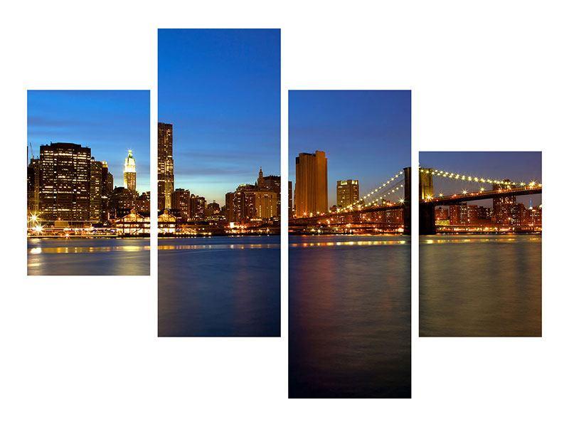 Leinwandbild 4-teilig modern Skyline Manhattan im Lichtermeer