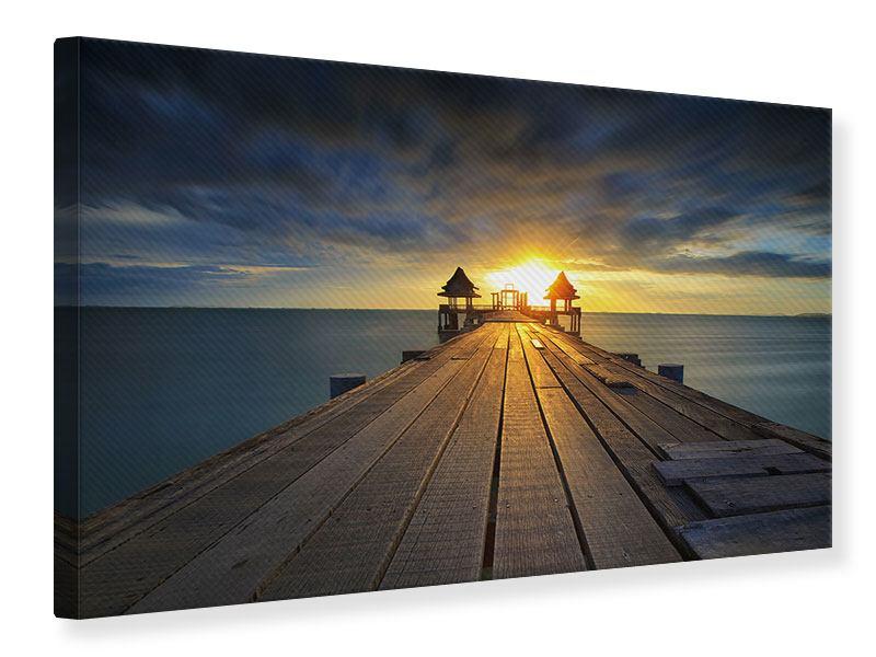 Leinwandbild Der Sonnenuntergang bei der Holzbrücke