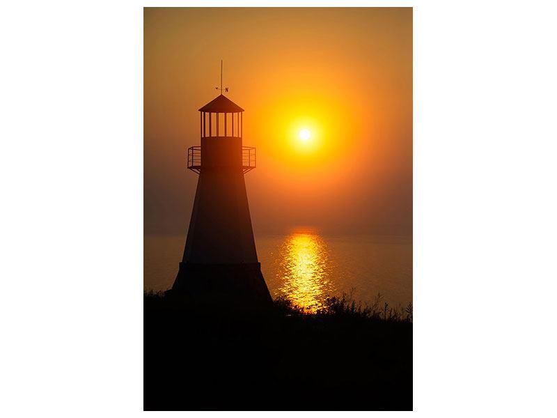 Leinwandbild Ein Leuchtturm bei Sonnenuntergang