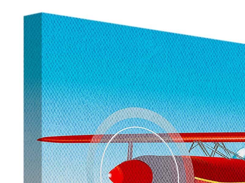 Leinwandbild Fliegendes Flugzeug