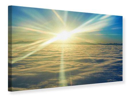 Leinwandbild Sonnenaufgang über den Wolken