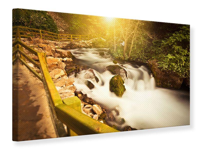 Leinwandbild Sonnenuntergang am Wasserfall