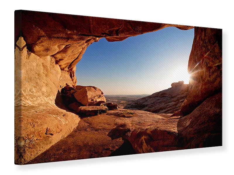 Leinwandbild Sonnenuntergang vor der Höhle