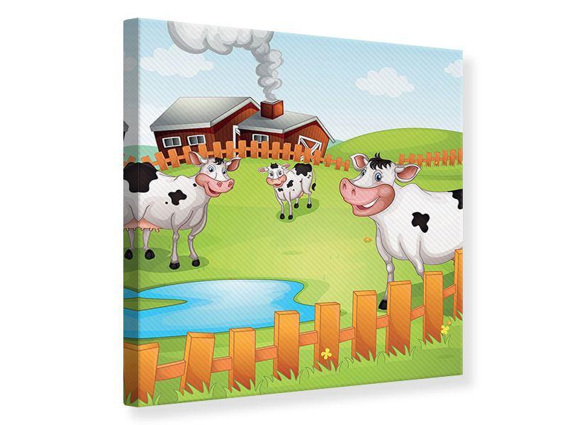 Leinwandbild Die lustigen Kühe