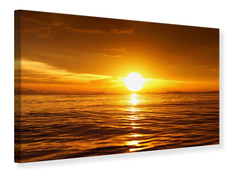 Leinwandbild Glühender Sonnenuntergang am Wasser