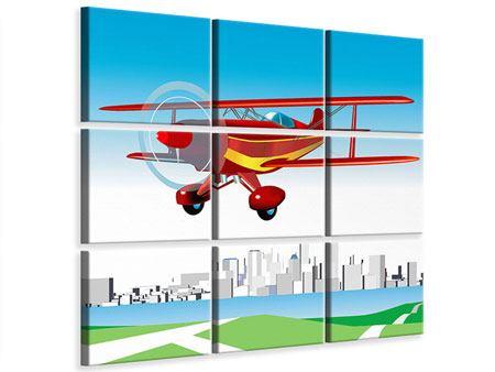 Leinwandbild 9-teilig Fliegendes Flugzeug