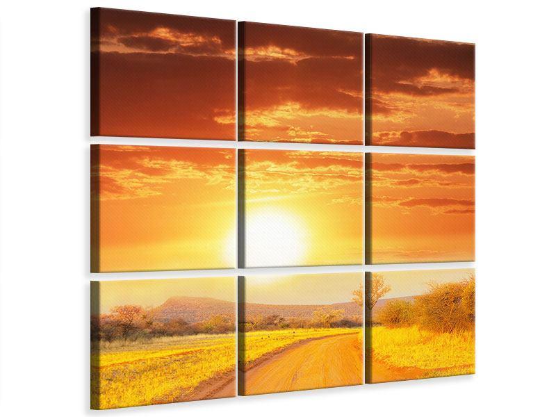 Leinwandbild 9-teilig Sonnenuntergang in der Savanne