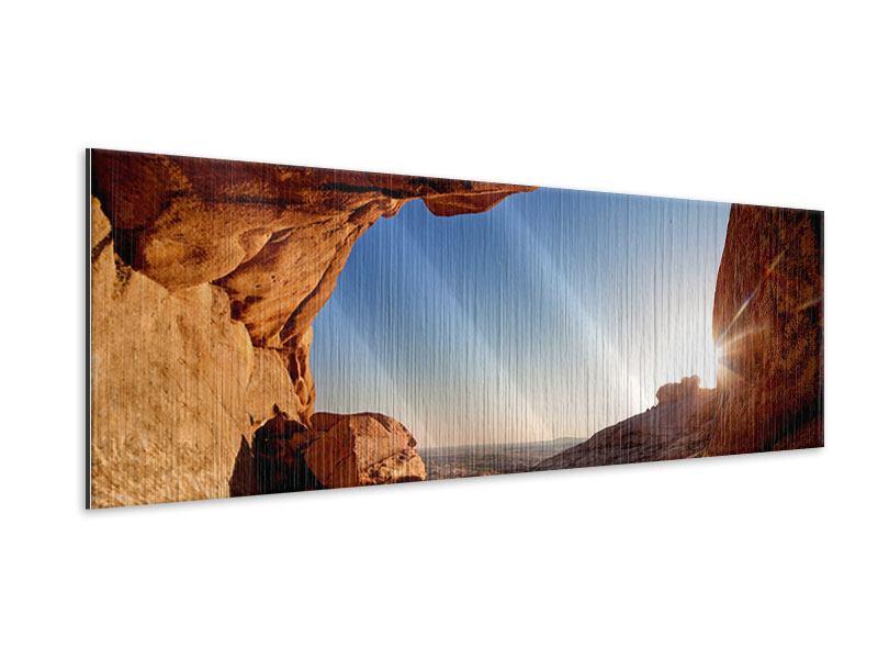 Metallic-Bild Panorama Sonnenuntergang vor der Höhle