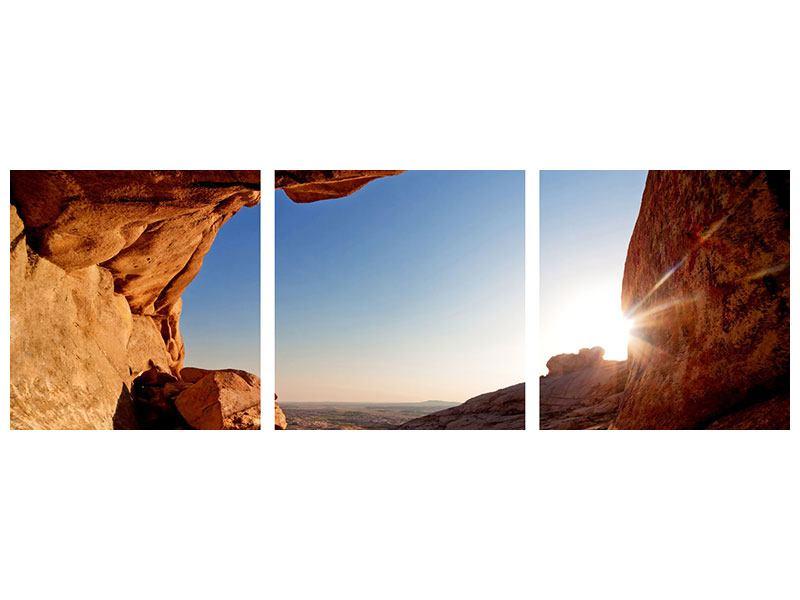Panorama Metallic-Bild 3-teilig Sonnenuntergang vor der Höhle