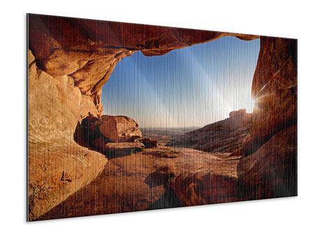 Metallic-Bild Sonnenuntergang vor der Höhle