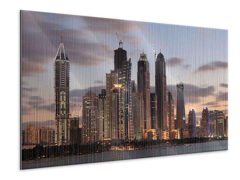 Metallic-Bild Skyline Dubai bei Sonnenuntergang
